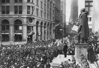 Thousands gather at the Subtreasury Building on Wall Street during Armistice Day, 1918.